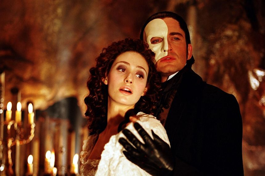 Actress Emmy Rossum as Christine and actor Gerard Butler sing in a scene from the movie version of The Phantom of the Opera.