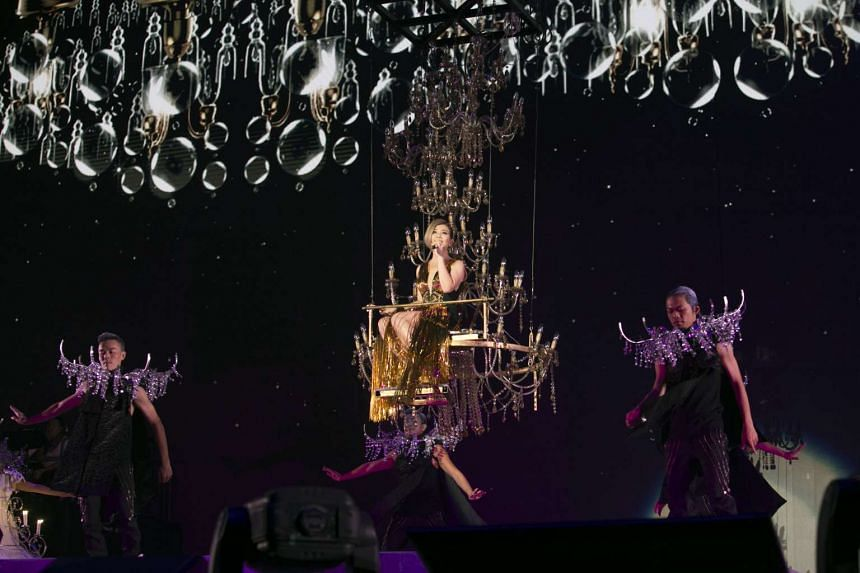 A highlight of the concert was when Fish Leong was lifted high above the stage in a chandelier as she sang Admiration.