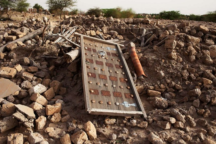 The ruins of a mausoleum seen after it was destroyed by an extremist militant in Timbuktu on July 25, 2013.