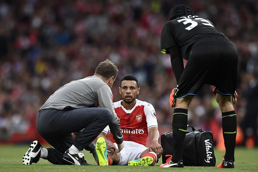 Arsenal's Francis Coquelin receiving medical attention after sustaining a injury during the match against Chelsea on Sept 24, 2016.