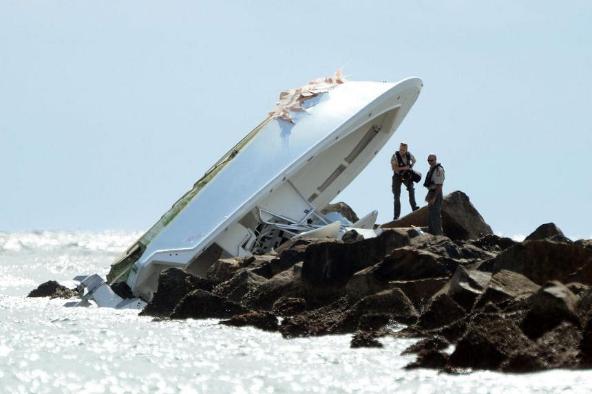 Investigators investigate the overturned boat on a jetty in which Miami Marlins pitcher Jose Fernandez was killed in Miami Beach.