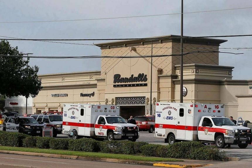 Ambulances arrive after a gunman went on a shooting rampage, wounding nine before he was shot and killed by police on Sept 26, 2016 in Houston, Texas.