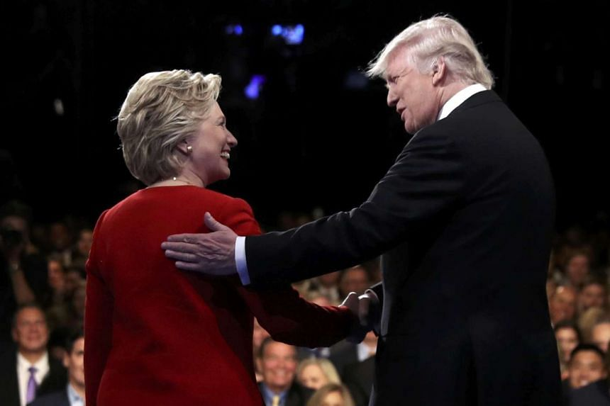 Republican US presidential nominee Donald Trump shakes hands with Democratic US presidential nominee Hillary Clinton at the start of their first presidential debate.