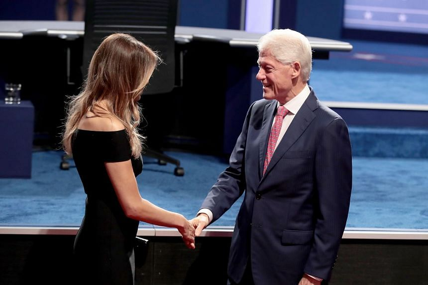 Mr Donald Trump's wife Melania greets Hillary Clinton's husband and former US president Bill Clinton at the presidential debate.