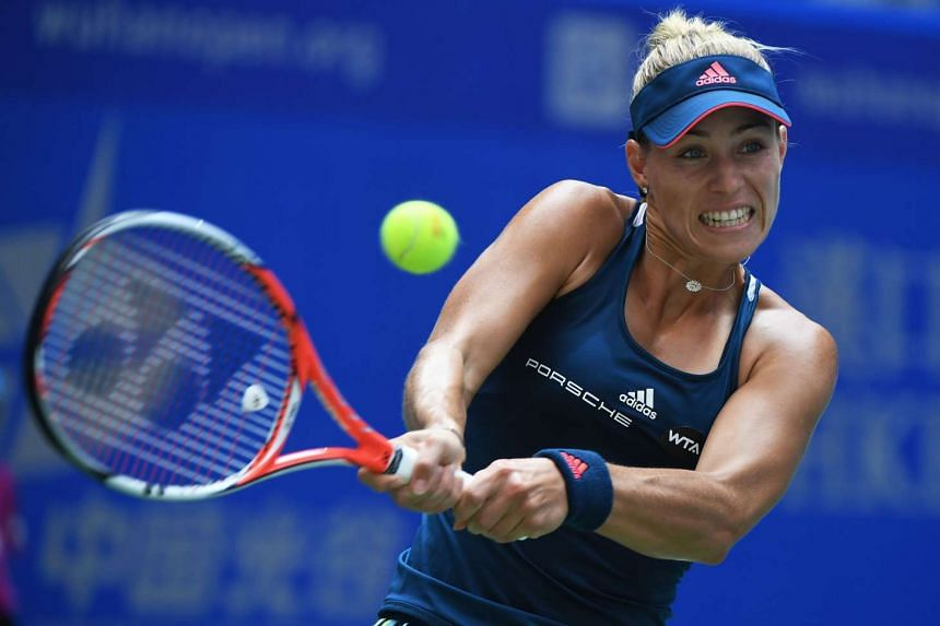 Angelique Kerber hitting a return to Kristina Mladenovic at the WTA Wuhan Open on Sept 27, 2016.