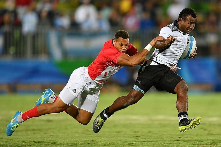 Dan Norton tackling Fiji's Leone Nakarawa in the Olympic final in Rio. The winger scored Britain's only try in their 43-7 drubbing.