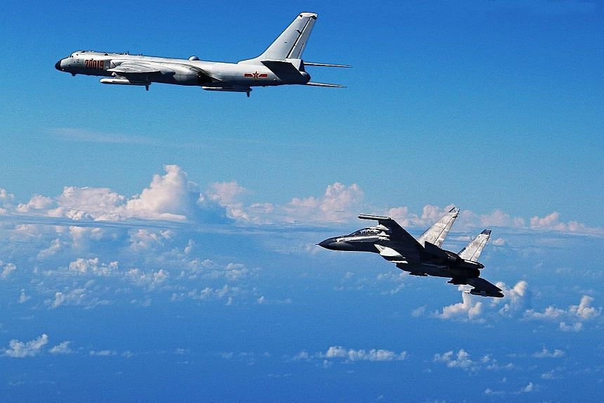 Chinese air force planes, including an H-6K bomber (left) and an Su-30 fighter, flying towards the Western Pacific over the Miyako Strait on Sunday.