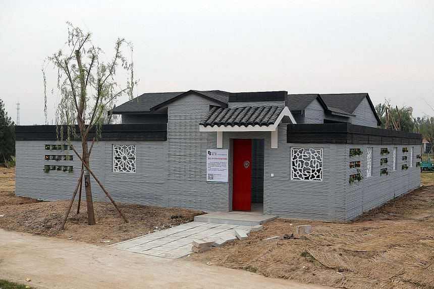 A villa built by 3D printing technology at a village in Binzhou, eastern China's Shandong province. The 3D-printed villa which uses no bricks in its construction costs 5,000 yuan (S$1,000) per sq m. Three months ago, a Chinese company 3D-printed a tw