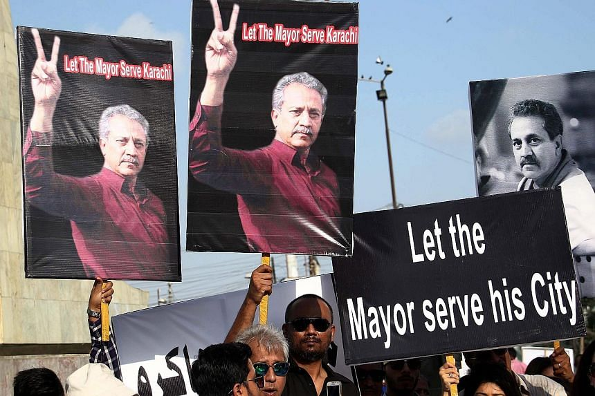 Supporters of Karachi's newly elected mayor Waseem Akhter rallying to demand his release from prison in Pakistan's largest city on Sunday. Akhter has been discharging his mayoral duties from a jail cell, where he has been held for inciting riots in 2