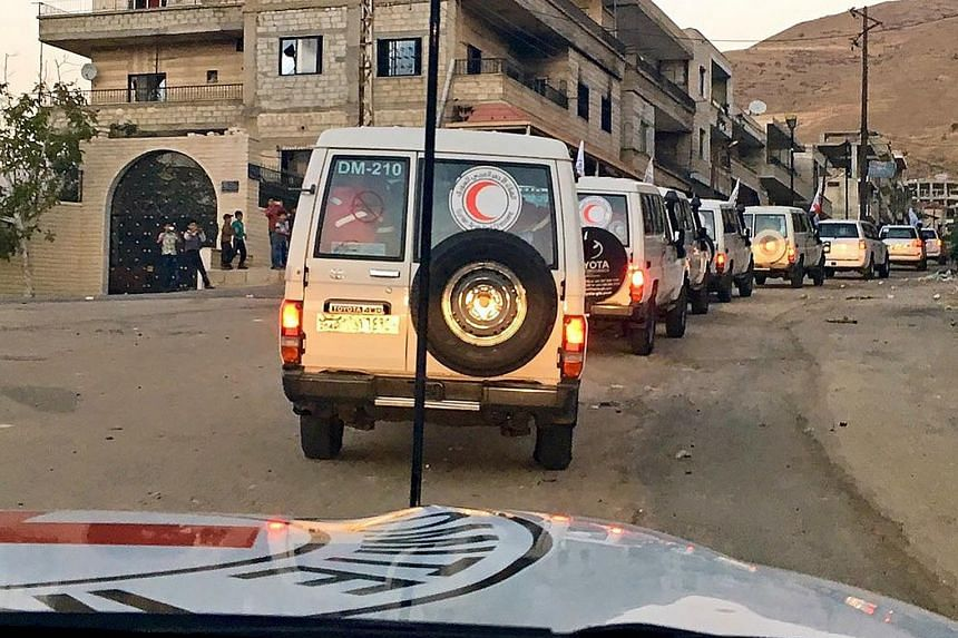 Aid being delivered on Sunday to besieged Syrian towns by the International Committee of the Red Cross for the first time in months. The Syrian Observatory for Human Rights, a Britain-based monitor, said that at least 128 people, nearly all civilians
