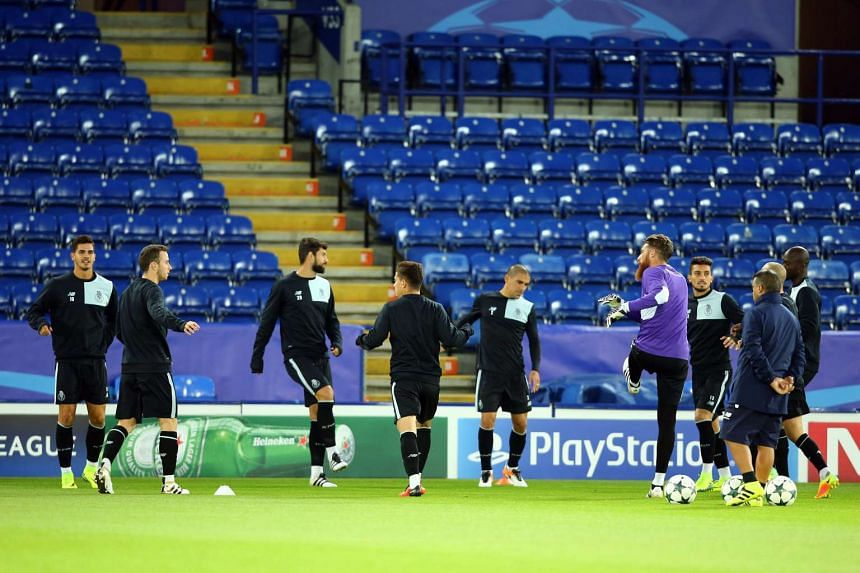 FC Porto's players take part in a training session at the King Power Stadium in Leicester, Britain, on Sept 26.
