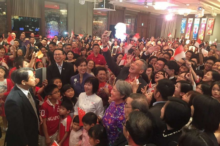 PM Lee Hsien Loong taking a wefie with Singaporeans in Tokyo at a National Day Reception on Sept 27, 2016.