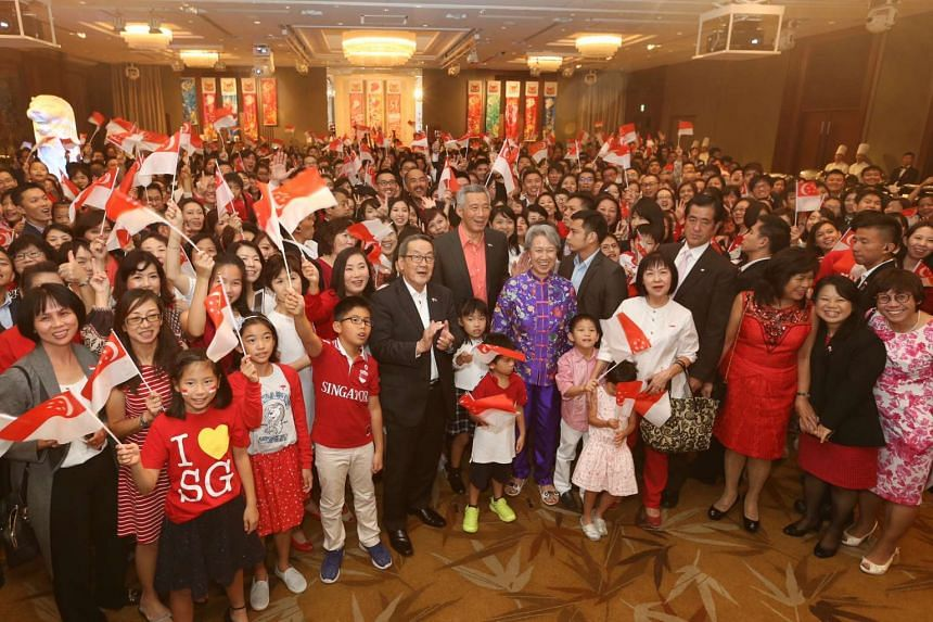 PM Lee Hsien Loong posing with Singaporeans living in Tokyo, during a National Day reception on Sept 27, 2016.