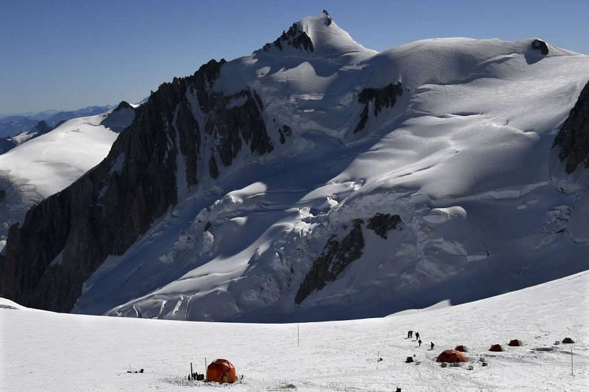 Researchers extract three ice cores from the Col du Dome glacier in August, as part of the Ice Memory project in Chamonix, eastern France. Two ice cores of more than 120 metres were extracted before being preserved in Antarctica as part of an operati