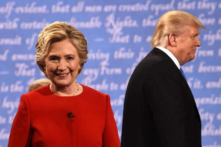 Democratic nominee Hillary Clinton and Republican nominee Donald Trump leave the stage after the first presidential debate at Hofstra University on Sept 27, 2016.