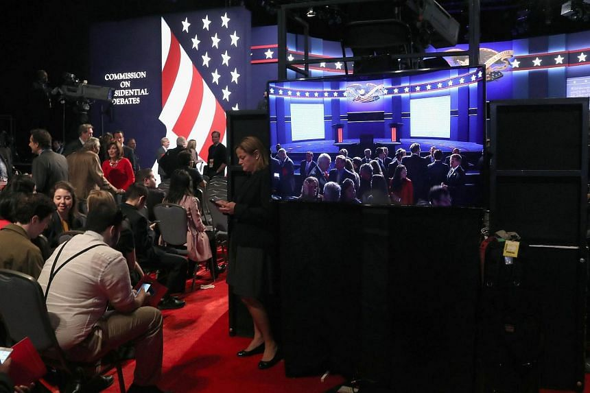 The audience gathers ahead of the presidential debate between Mrs Hillary Clinton and Mr Donald Trump at Hofstra University on Sept 26, 2016 in Hempstead, New York.