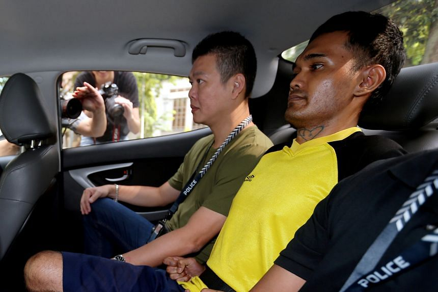 Sabri Aslam (in yellow) is accused of causing the death of his 60-year-old father, Mr Aslam Alodin, last Saturday. The prosecution applied for Sabri to be remanded at Complex Medical Centre in Changi for psychiatric assessment, saying that he faces a