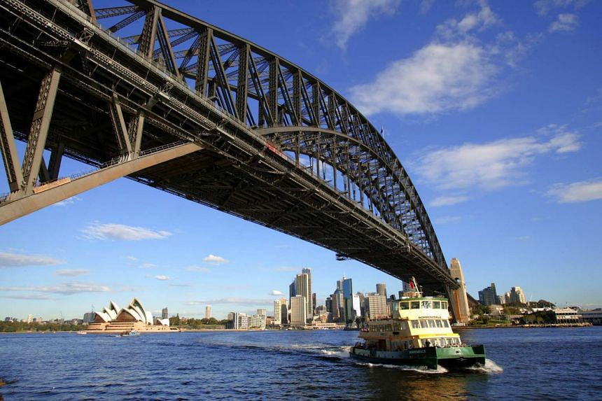 Australia watered down plans for a tax on foreigners on working holidays, after an outcry from farmers and tourism operators.
