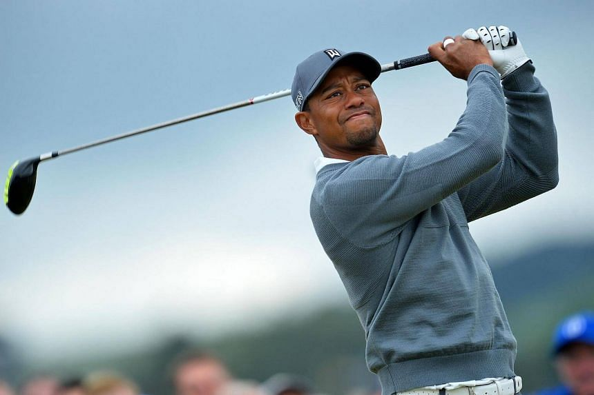 This file photo taken on July 16, 2015 shows US golfer Tiger Woods watching his shot from the 4th tee during the 2015 British Open Golf Championship in Scotland.