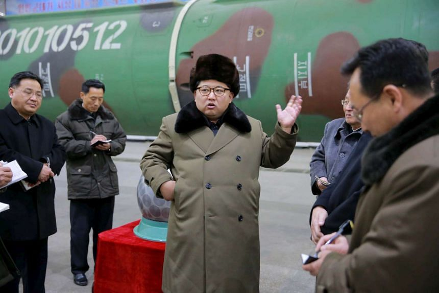 North Korean leader Kim Jong Un meets scientists and technicians in the field of research into nuclear weapons. Four Chinese nationals and a China-based company have been charged in the United States for evading its sanctions against North Korea's nu