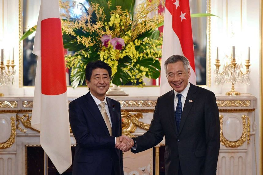 Prime Minister Lee Hsien Loong (right) shaking hands with his Japanese counterpart Shinzo Abe before their meeting at the state guest house in Tokyo on Sept 28, 2016.