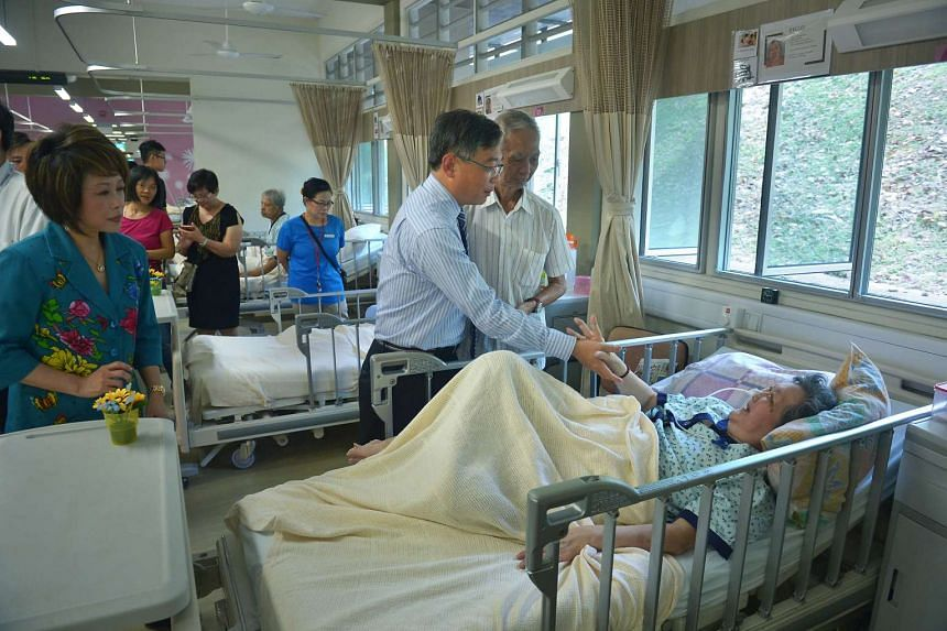 Health Minister Gan Kim Yong speaking with a resident of Pearl's Hill Care Home on Sept 28, 2016.