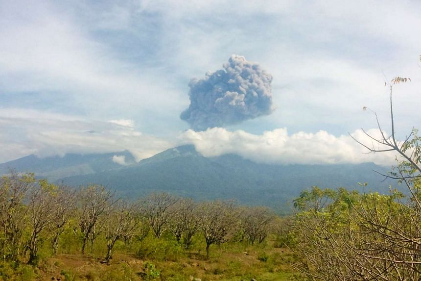 Mount Barujari, located inside Mount Rinjani, is seen erupting from the Bayan district in North Lombok, Indonesia on Sept 27, 2016.