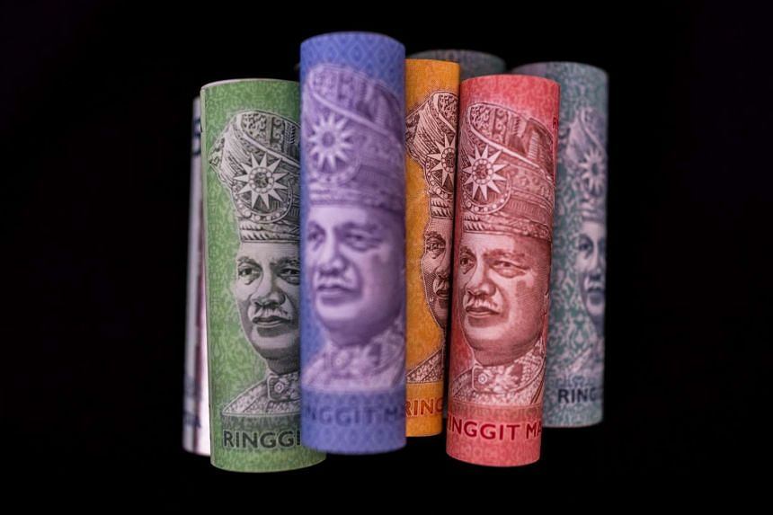 Malaysian ringgit banknotes of various denominations are arranged for a photograph in Kuala Lumpur.