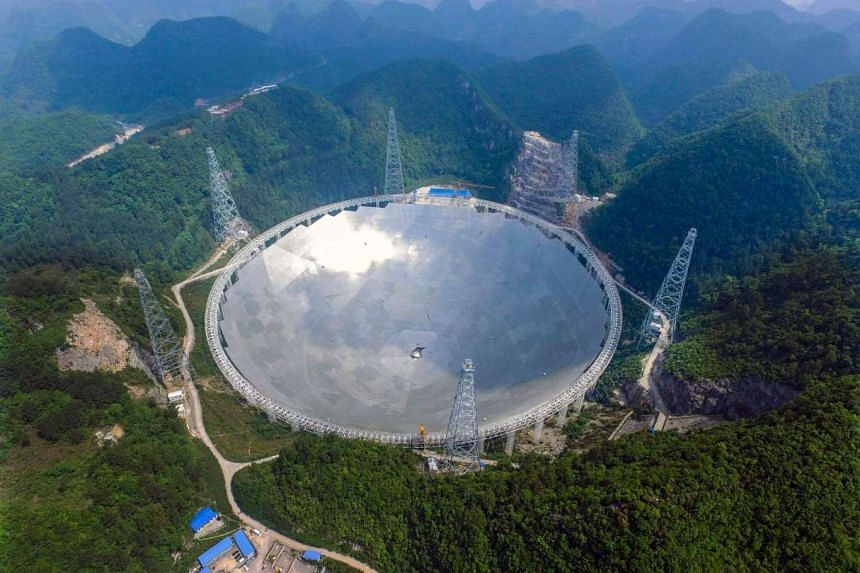 A general view on the five-hundred-meter Aperture Spherical radio Telescope (FAST) under construction in the remote Pingtang county, China.