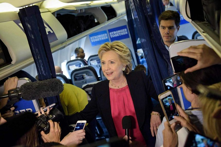 Democratic presidential nominee Hillary Clinton speaks to press on her plane at Westchester County Airport.