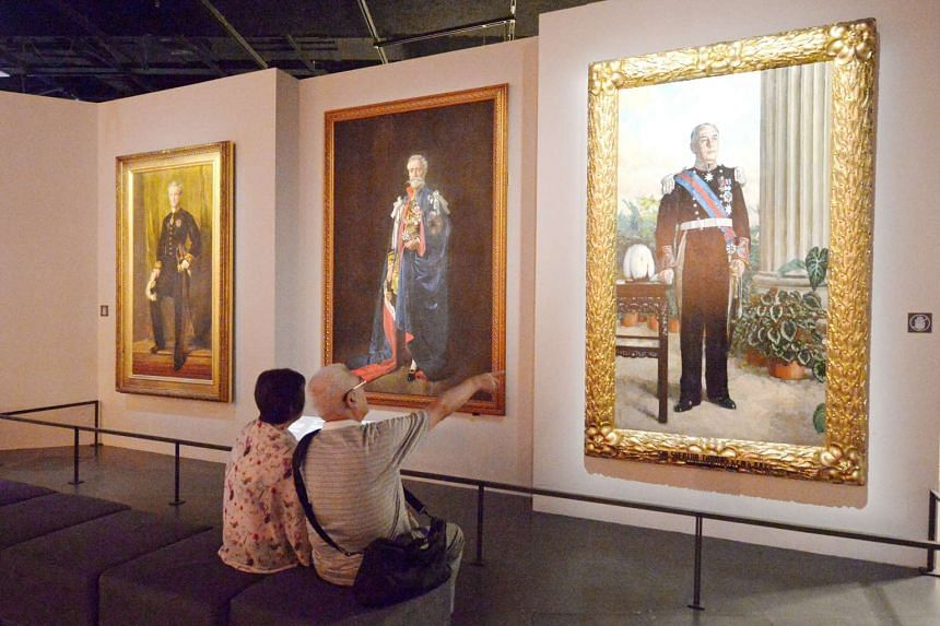 Visitors look at portraits at the Singapore History Gallery, inside the National Museum of Singapore.