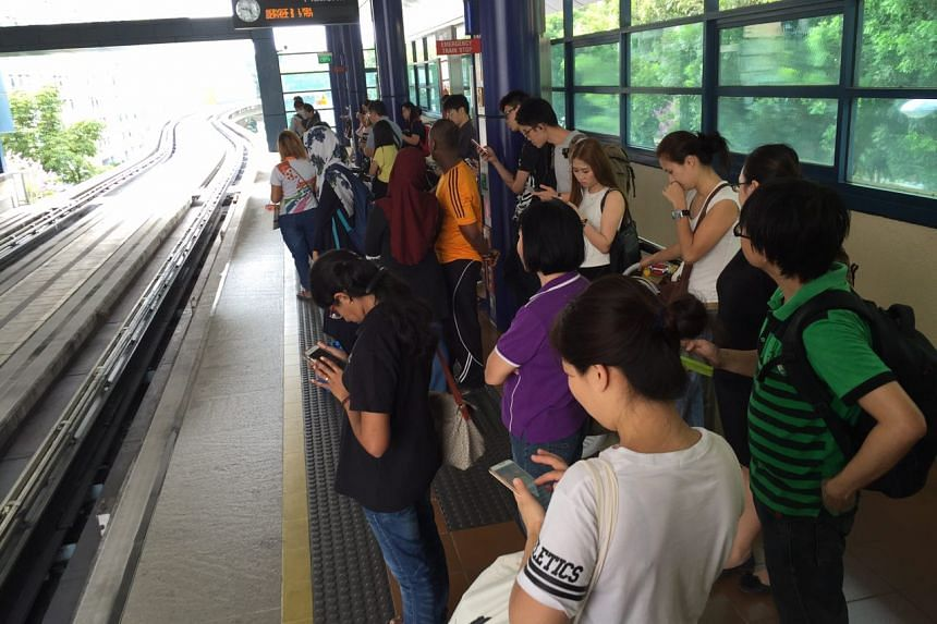 Commuters waiting for the train at Segar station on the Bukit Panjang LRT on Wednesday morning.