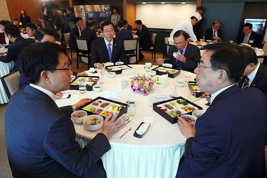 Lawmakers tucking into US$22 (S$29.90) meal sets during a parliamentary audit of the Land, Infrastructure and Transport committee at the Incheon International Airport. South Korea has made it illegal for government employees, private school teachers