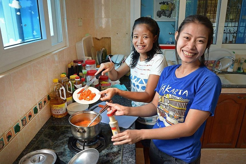 Indonesians Wiwik Mariyati, 34, and Carsih Carman Taja (far right), 29, work here as domestic helpers. The number of helpers like them as well as dependants on long-term visit passes, grew over the past year, contributing to the growth in non-residen