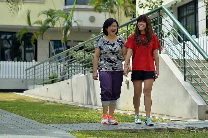 Breast cancer survivor Lim Loo See, 55, with her daughter Charmian Yeo, a 26-year-old student.