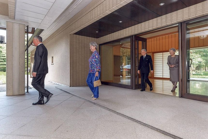 Japanese Emperor Akihito and Empress Michiko seeing off PM Lee and Mrs Lee after their private lunch at the Imperial Palace yesterday. PM Lee is in Tokyo for a four-day official visit that started on Monday, to mark 50 years of diplomatic ties betwee