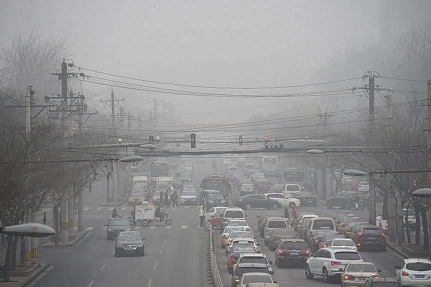 Smog in the air in Beijing. WHO official Maria Neira is urging governments to cut the number of vehicles on the road, improve waste management and promote clean cooking fuel.