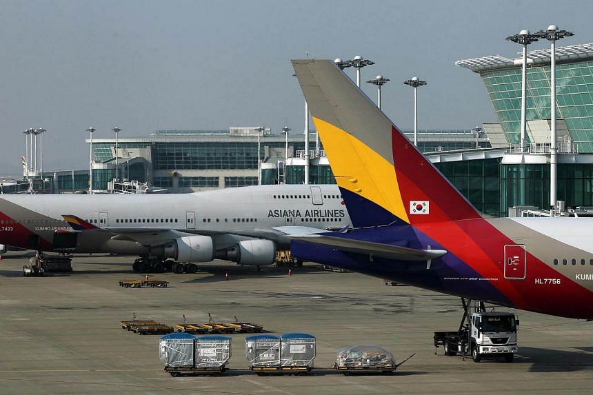 Asiana Airlines Inc. aircraft stand on the tarmac at Incheon International Airport in Incheon, South Korea on Jan 10, 2012.
