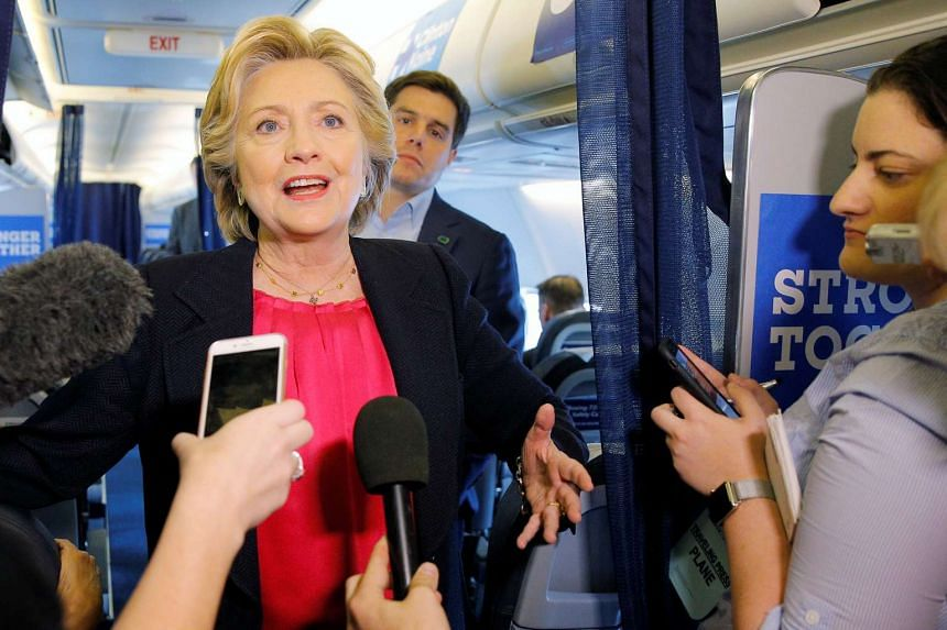 Clinton talks to reporters on her campaign plane in White Plains, New York, on Sept 27, 2016.