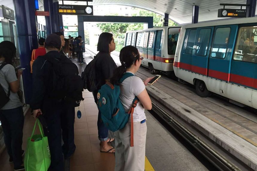 Commuters waiting for the train at Petir station on the Bukit Panjang LRT at around 8.45am on Wednesday morning.