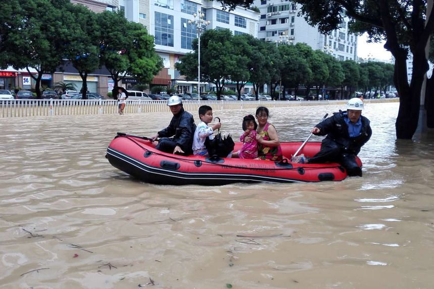People take a boat at a flooded area as Typhoon Megi lands in Fuzhou, in China's Fujian province, Sept 28, 2016.