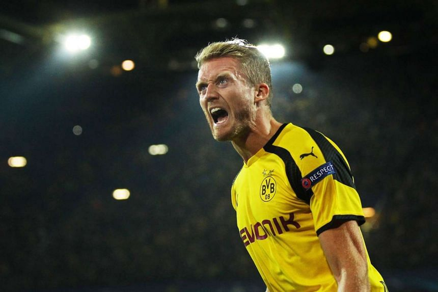 Dortmund's Andre Schuerrle celebrates after scoring the 2-2 equaliser.