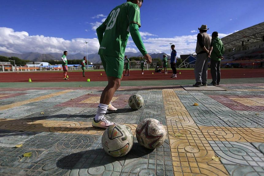 Tibetan football players training at the Pureland Men's Football Club in Lhasa, Tibet.