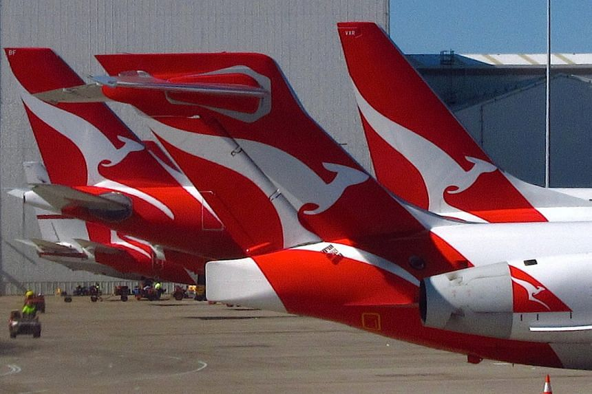 Qantas has warned of the danger of mobile phones being crushed in reclinable plane seats and catching fire after one ignited during a US flight.