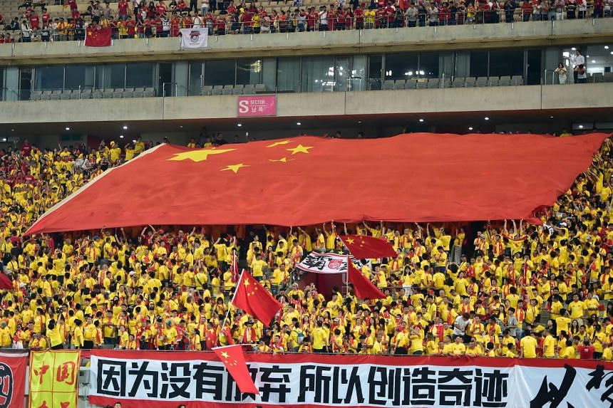 Chinese fans carrying a huge national flag during the 2018 World Cup qualifying football match between South Korea and China in Seoul on Sept 1, 2016.