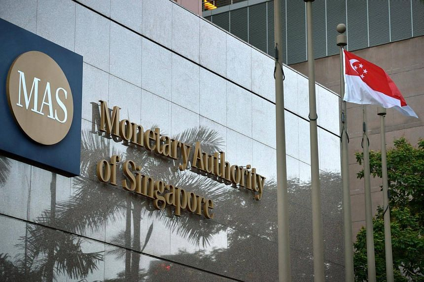 The Monetary Authority of Singapore (MAS) building in the evening.