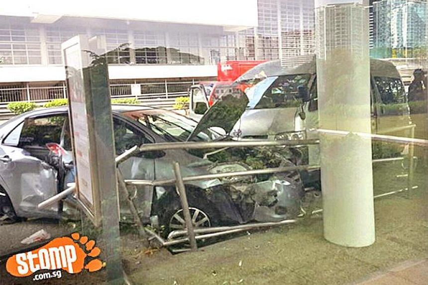 The car and minibus crashed into a bus stop opposite Singapore Polytechnic before 8.30am on Sept 27, 2016.