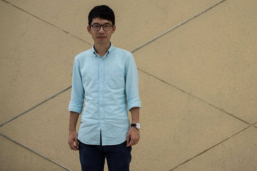 23-year-old Nathan Law, Hong Kong's youngest ever lawmaker, poses after an interview with AFP at Lingnan University in Hong Kong.