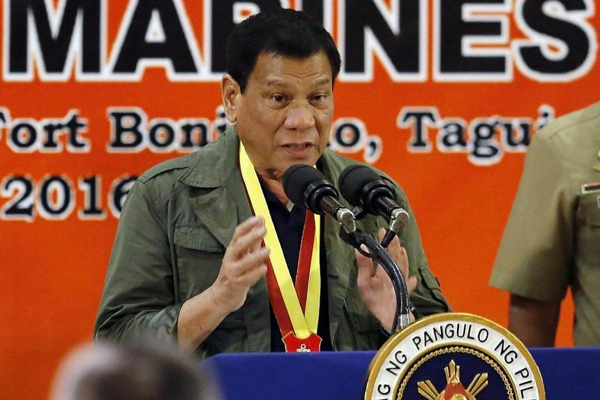 Filipino President Rodrigo Duterte speaks during his visit at the Philippine Marines headquarters in Taguig city, south of Manila, Philippines on Sept 27, 2016.
