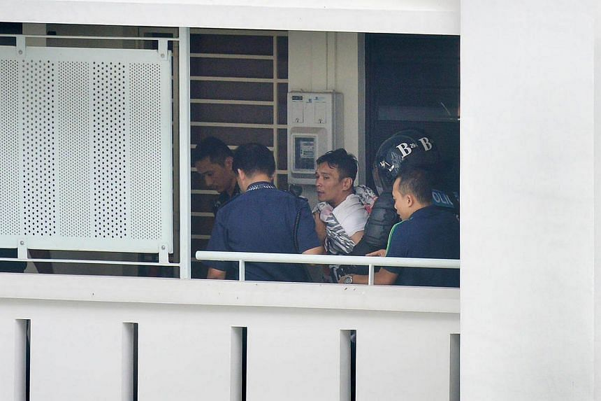 Police officers arrested the man who had locked himself in a Sembawang flat with a two-year-old boy after a 17-hour stand-off.